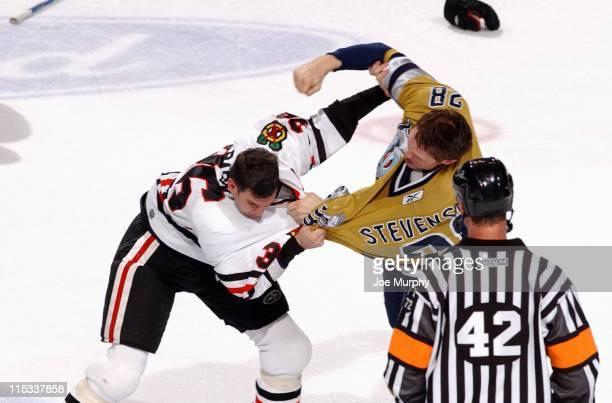 Blackhawks Matthew Barnaby fights with Jeremy Stevenson in the third period. The Nashville Predators beat the Chicago Blackhawks 5-3 on October 25,...