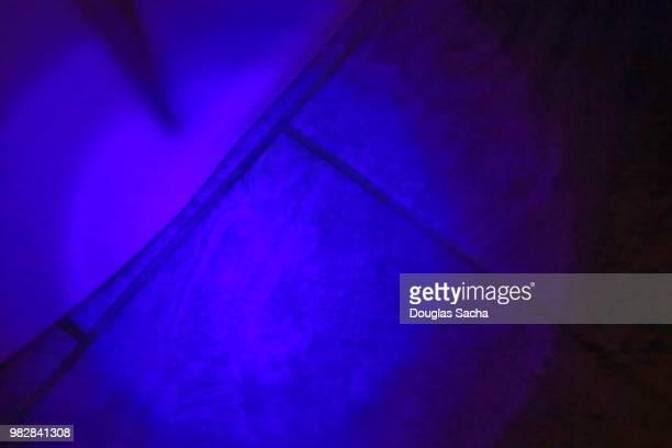 UV Black-light illuminating the glowing urine