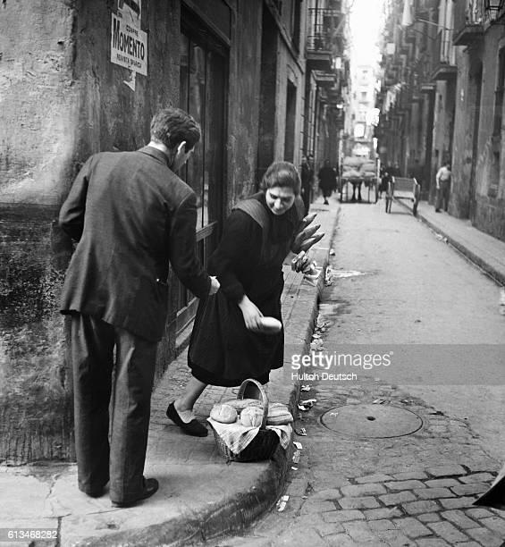 Blackmarketeering In Bread On A Street Corner In Barcelona