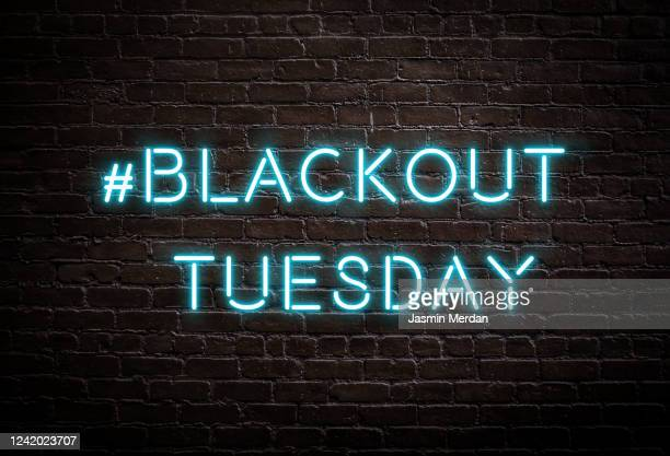 blackout tuesday # hashtag on brick wall - blackout tuesday stock pictures, royalty-free photos & images