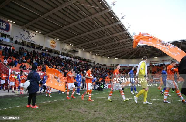 Blackpool and Gillingham players make their way out on to the pitch prior to kickoff