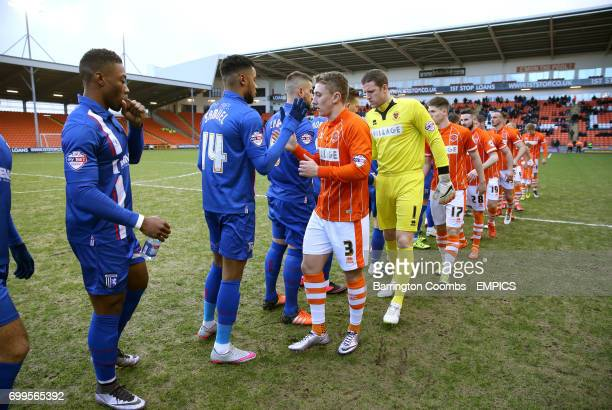 Blackpool and Gillingham players shake hands prior to kickoff