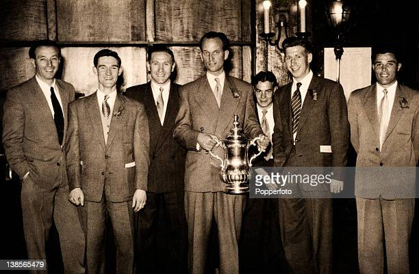 Blackpool captain Harry Johnston holding the FA Cup with some of the Blackpool team during the civic reception at Blackpool Town Hall two days after...