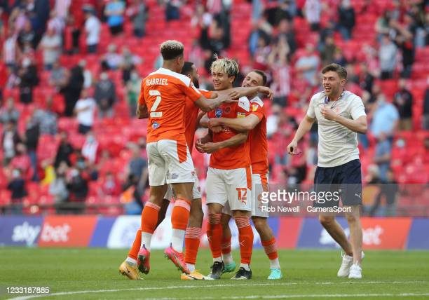 Blackpool celebrate at the final whistle with goal scorer Kenny Dougall in the middle of the crowd during the Sky Bet League One Play-off Final match...