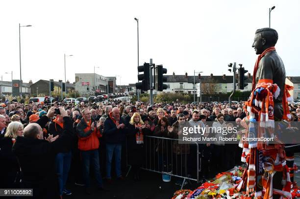 Blackpool fans acknowledge a minutes applause to pay their respects to the late Jimmy Armfield during the Sky Bet League One match between Blackpool...