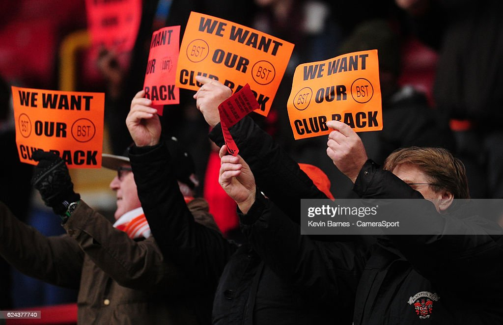 Blackpool fans protest against the clubs' owners during the Sky Bet League Two match between Leyton Orient and Blackpool at Brisbane Road on November 19, 2016 in London, England.