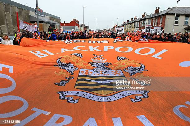 Blackpool fans unfurl a giant banner as they take part in a protest before the Sky Bet Championship match between Blackpool and Huddersfield Town at...