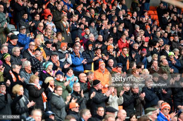 Blackpool FC fans applaud after wreaths were laid in the goal mouth in front of the Armfield stand to honour the late Jimmy Armfield during the Sky...