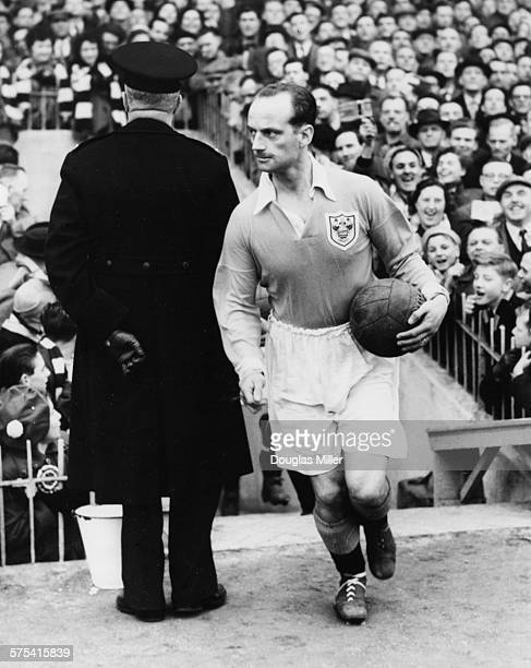 Blackpool Football Club captain Harry Johnston runs in to the ground holding the game ball at the start of a match against Tottenham Hotspur FC...