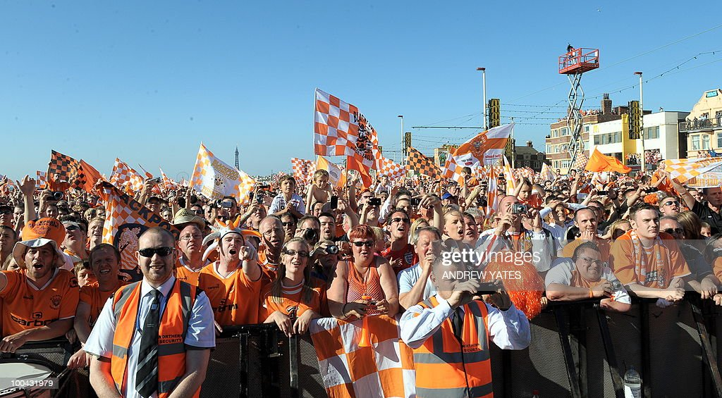 Blackpool football fans cheer at their promotion party in Blackpool, north west England, on May 24, 2010, after winning promotion to the Premier League by beating Cardiff.