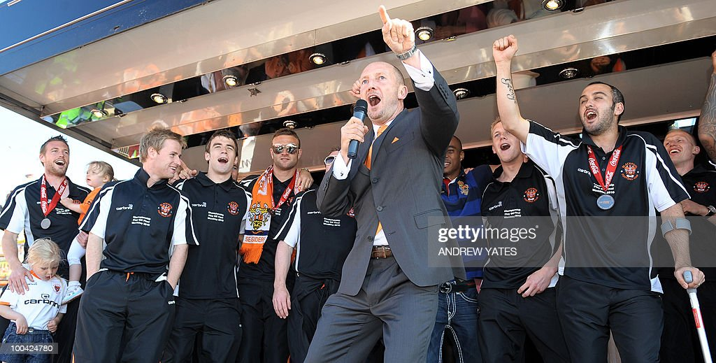 Blackpool football manager Ian Holloway (C) leads his player in a sing song at their promotion party in Blackpool, north west England, on May 24, 2010, after winning promotion to the Premier League by beating Cardiff.