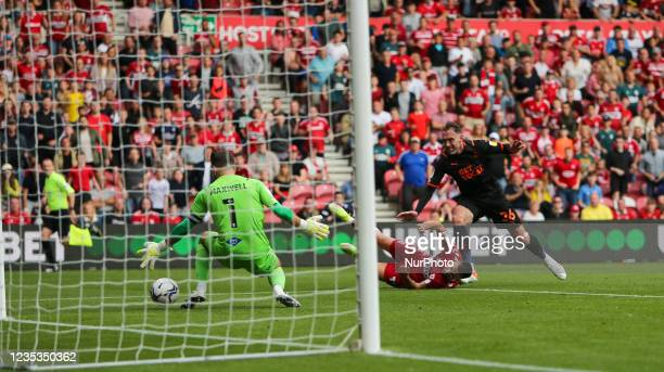 Blackpool Goalkeeper Chris Maxwell saves from Middlesbrough's Andra porar during the Sky Bet Championship match between Middlesbrough and Blackpool...