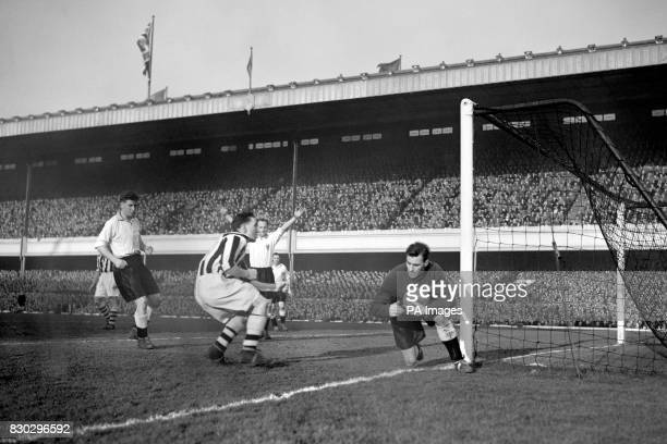 Blackpool goalkeeper Farm saves from Arsenal player Logie during their FA Cup 6th round match at Highbury Stadium London