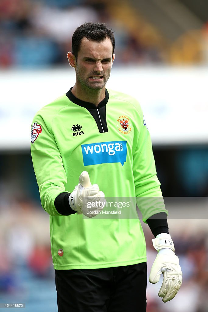 Blackpool goalkeeper Joe Lewis gestures during the Sky Bet Championship match between Millwall and Blackpool at The Den on August 30, 2014 in London, England.
