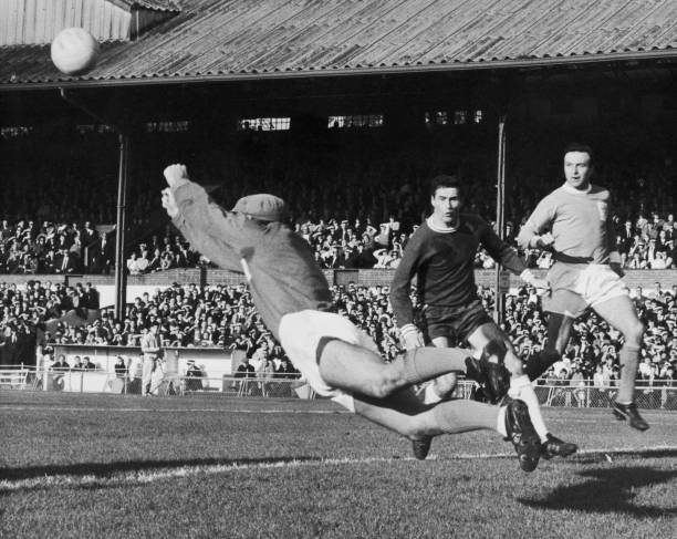 Blackpool goalkeeper Tony Waiters punches a shot from Chelsea's George Graham clear of the goal during a match at Stamford Bridge, London, 9th...