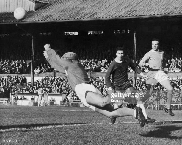 Blackpool goalkeeper Tony Waiters punches a shot from Chelsea's George Graham clear of the goal during a match at Stamford Bridge London 9th October...