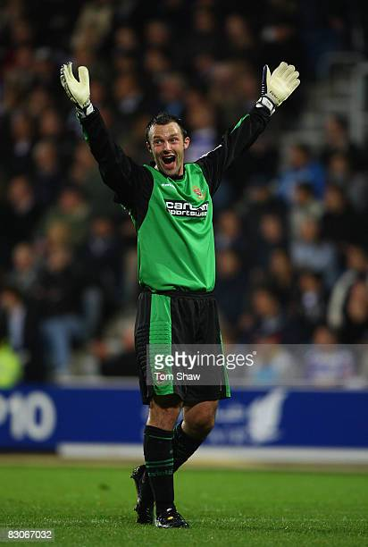 Blackpool keeper Paul Rachubka celebrates the opening goal during the Coca Cola Championship match between Queens Park Rangers and Blackpool at...