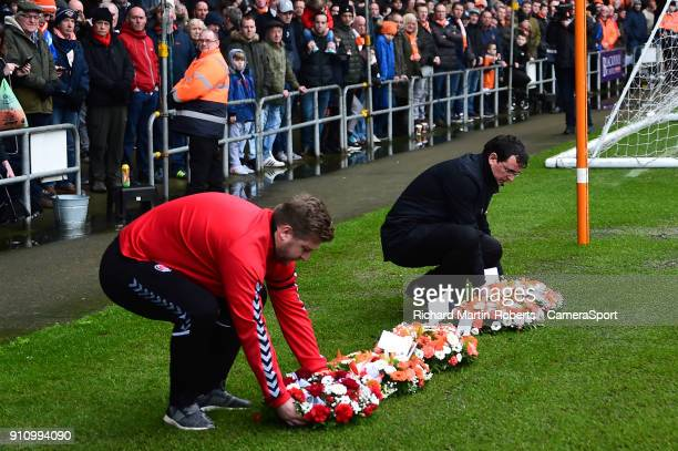 Blackpool manager Gary Bowyer and Charlton Athletic manager Karl Robinson lay wreaths in the goal mouth in front of the Armfield stand to honour the...