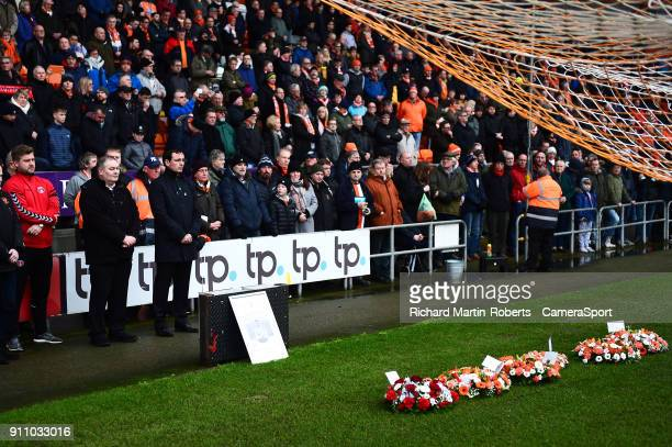 Blackpool manager Gary Bowyer and Charlton Athletic manager Karl Robinson look on after laying wreaths in the goal mouth in front of the Armfield...