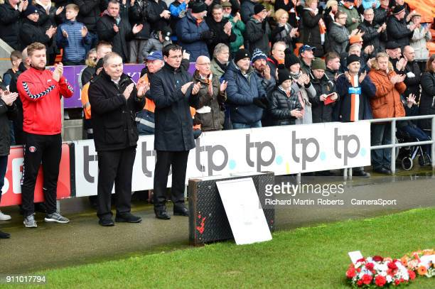 Blackpool manager Gary Bowyer and Charlton Athletic manager Karl Robinson applaud after laying wreaths in the goal mouth in front of the Armfield...