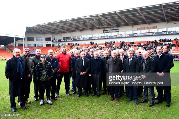 Blackpool manager Gary Bowyer and Charlton Athletic manager Karl Robinson pose with former Blackpool FC players after laying wreaths in the goal...