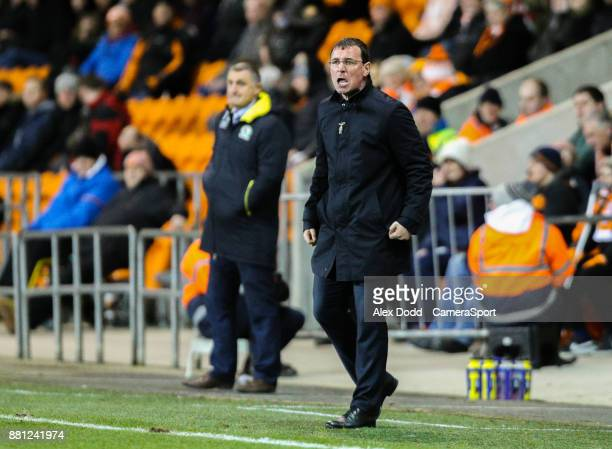 Blackpool manager Gary Bowyer shouts instructions to his team from the technical area during the Sky Bet League One match between Blackpool and...