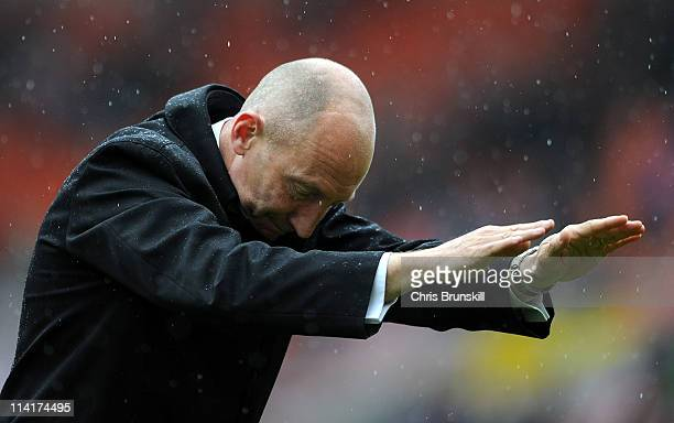 Blackpool manager Ian Holloway bows infront of the supporters following the Barclays Premier League match between Blackpool and Bolton Wanderers at...