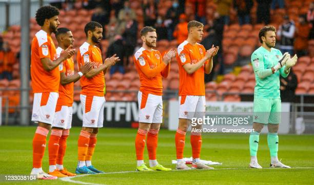 Blackpool players applaud in memory of Jordan Banks, a nine-year-old boy who was struck by lighting and killed, before the Sky Bet League One...