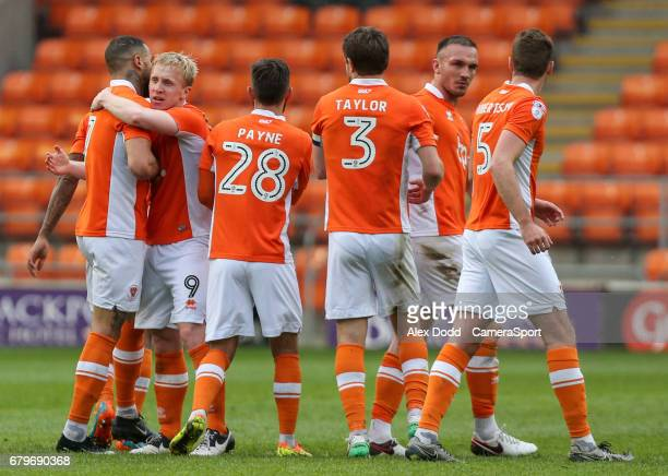 Blackpool players celebrate their second goal scored by Mark Cullen during the Sky Bet League Two match between Blackpool and Leyton Orient at...