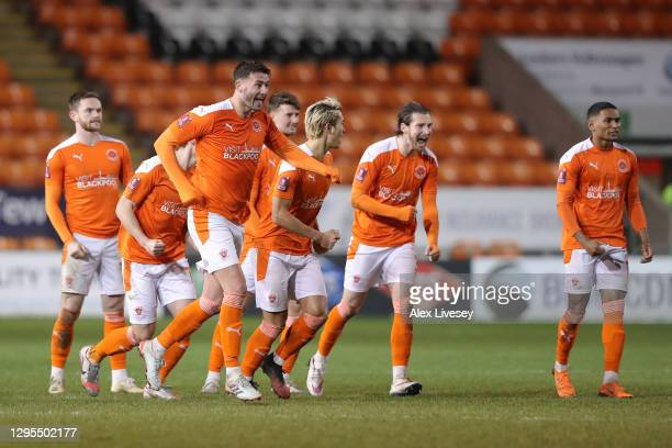 Blackpool players celebrate victory in the penalty shoot out after the FA Cup Third Round match between Blackpool and West Bromwich Albion on January...