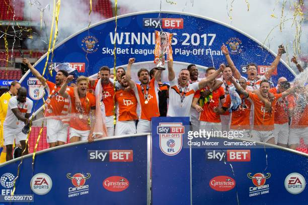 Blackpool players celebrate with the winners trophy during the EFL Sky Bet League Two PlayOff Final match between Blackpool and Exeter City at...