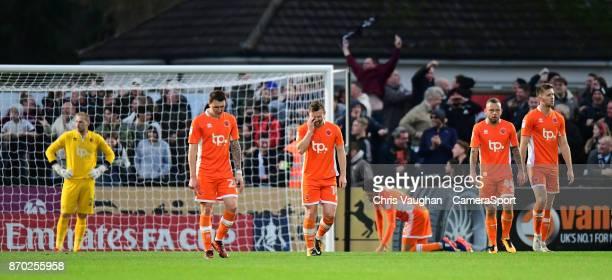Blackpool players from left Ryan Allsop Callum Cooke Jimmy Ryan Kelvin Mellor Jay Spearing and Will Aimson react after Boreham Wood's Blair Turgott...