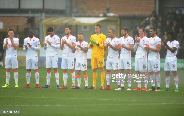 Blackpool players observe a minutes' applause in memory of Cyrille Regis during the Sky Bet League One match between AFC Wimbledon and Blackpool at...