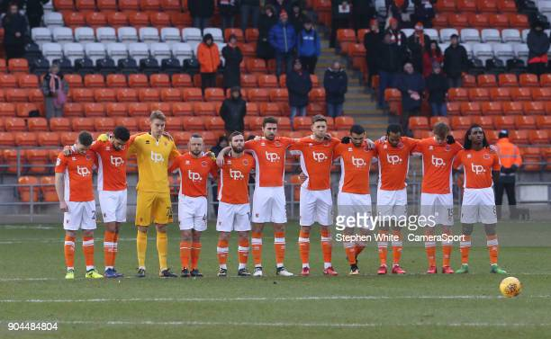 Blackpool players stand in silence to remember the clubs fans who passed away in 2017 during the Sky Bet League One match between Blackpool and...