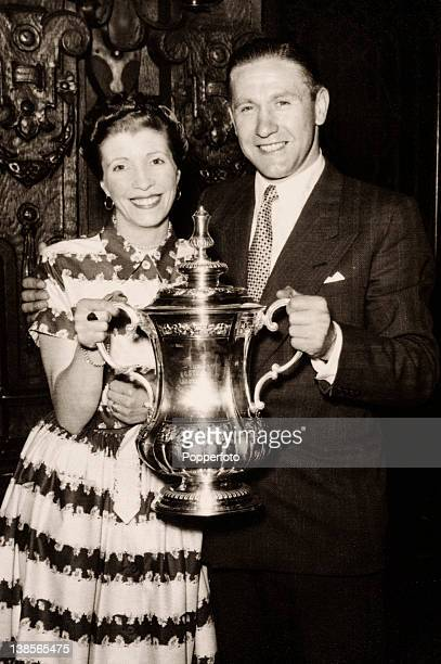 Blackpool striker Stan Mortensen with his wife Jean and the FA Cup during the civic reception at Blackpool Town Hall two days after their thrilling...