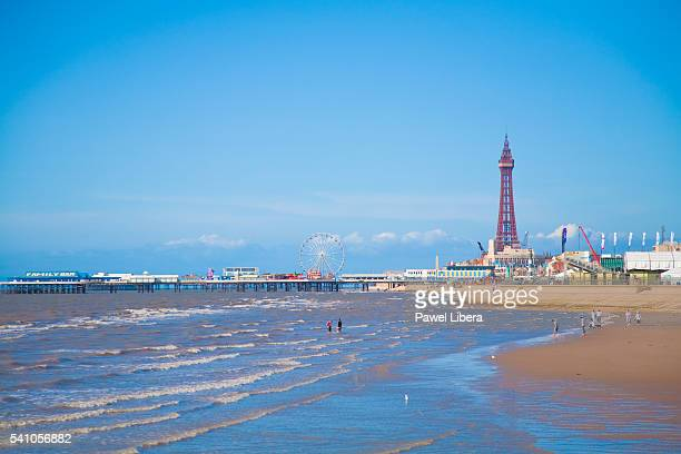 blackpool tower and beach at low tide - blackpool beach stock pictures, royalty-free photos & images