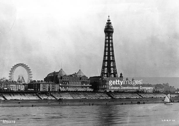 Blackpool Tower and sea front, Lancashire, the fairground ferris wheel visible on the left.