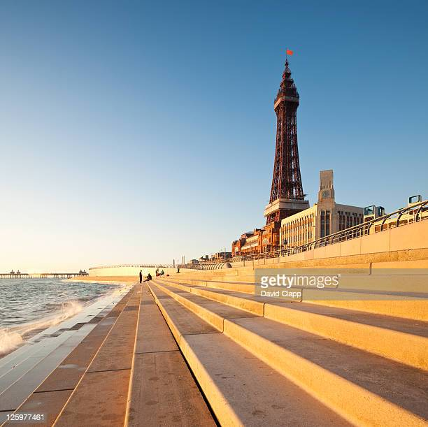 blackpool tower, created and built by charles tuke and james maxwell, on blackpool beach, blackpool, lancashire, england, uk - lancashire stock pictures, royalty-free photos & images