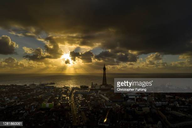 Blackpool Tower is silhouetted by brooding clouds over the Irish as Blackpool Council send out an SOS message to the government on October 23, 2020...