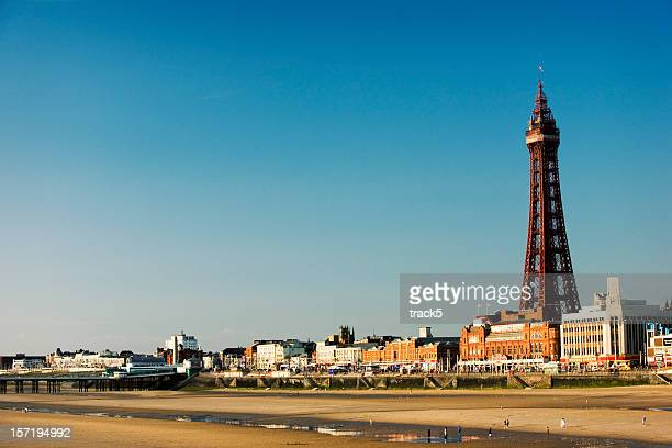 blackpool tower. the promenade and the sandy beach, lancashire, uk - blackpool stock photos and pictures
