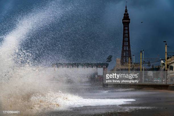 blackpool tower with massive waves - stiff stock pictures, royalty-free photos & images