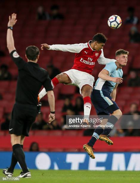 Blackpool U18's Jack Newton competing with Arsenal U18's Xavier Amaechi during the FA Youth Cup Semi Final Second Leg match between Arsenal U18 and...