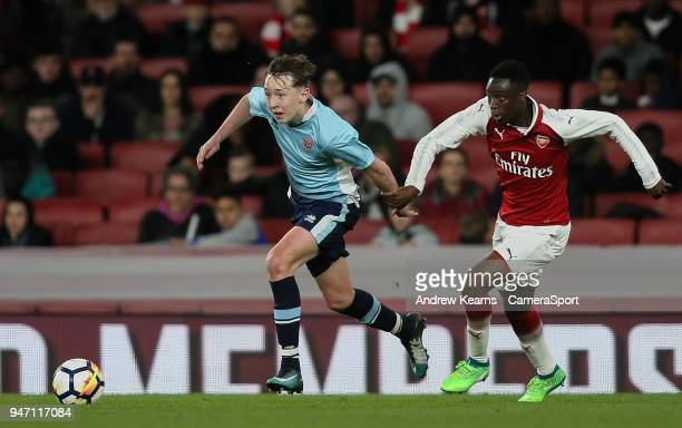 LONDON ENGLAND APRIL Blackpool U18's Nathan Shaw competing with Arsenal U18's James Olayinka during the FA Youth Cup Semi Final Second Leg match...