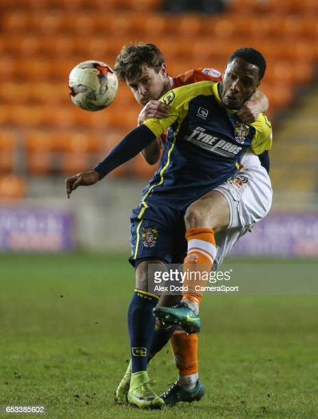 Blackpool's Andy Taylor battles with Stevenage's Kaylen Hinds during the Sky Bet League Two match between Blackpool and Stevenage at Bloomfield Road...