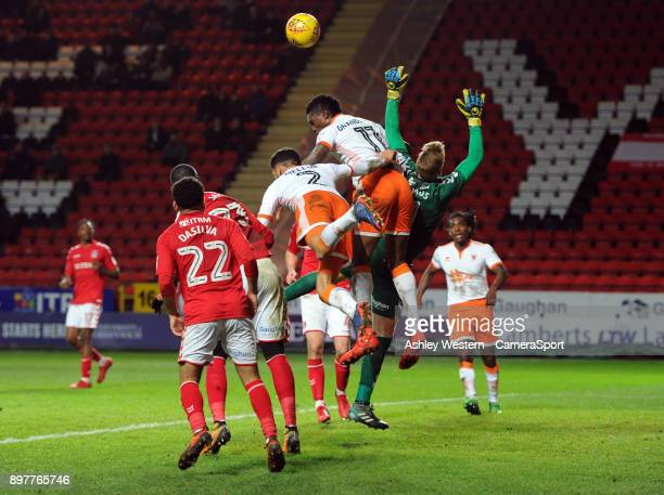 LONDON ENGLAND DECEMBER Blackpool's Armand Gnanduillet and Kelvin Mellor battles for possession with Charlton Athletic's Ben Amos during the Sky Bet...