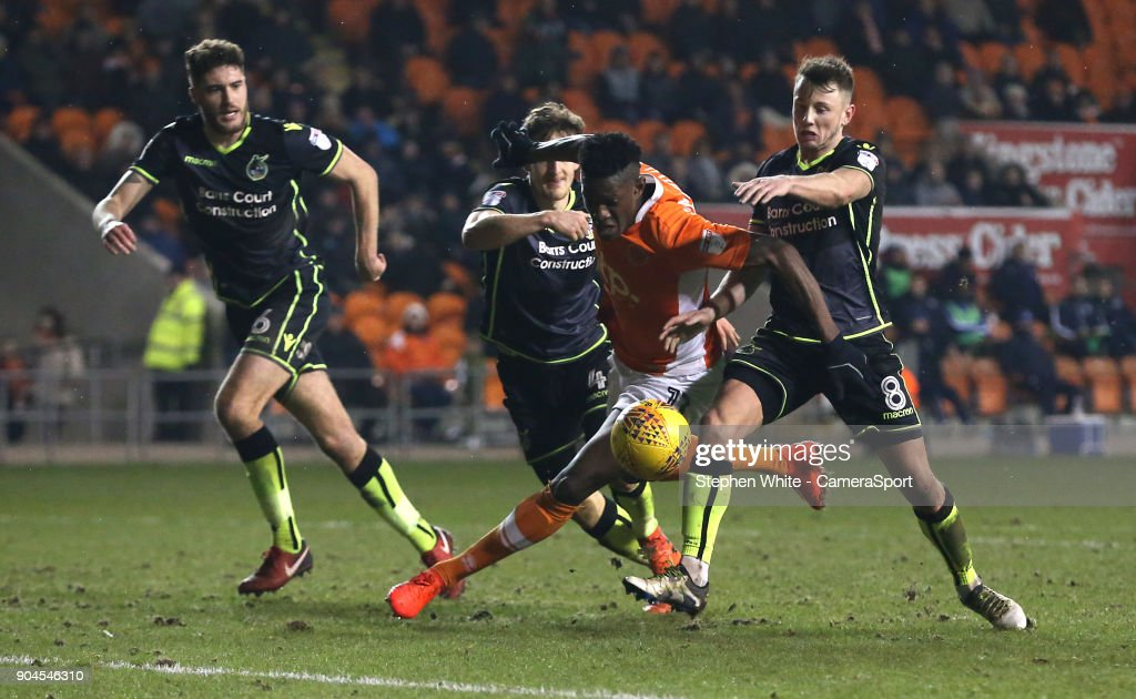 Blackpool's Armand Gnanduillet battles against Bristol Rovers' Ollie Clarke (right) and Tom Lockyer during the Sky Bet League One match between Blackpool and Bristol Rovers at Bloomfield Road on January 13, 2018 in Blackpool, England.
