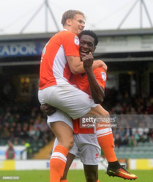Blackpool's Armand Gnanduillet celebrates Blackpools third goal with team mate Brad Potts during the Sky Bet League Two match between Yeovil Town and...
