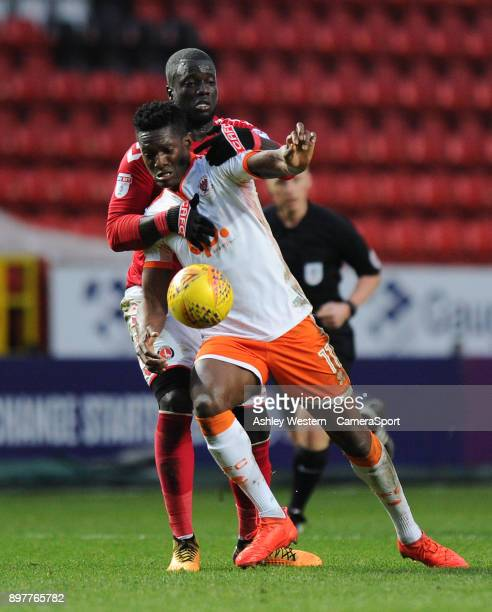 Blackpool's Armand Gnanduillet holds off the challenge from Charlton Athletic's MouhamadouNaby Sarr during the Sky Bet League One match between...