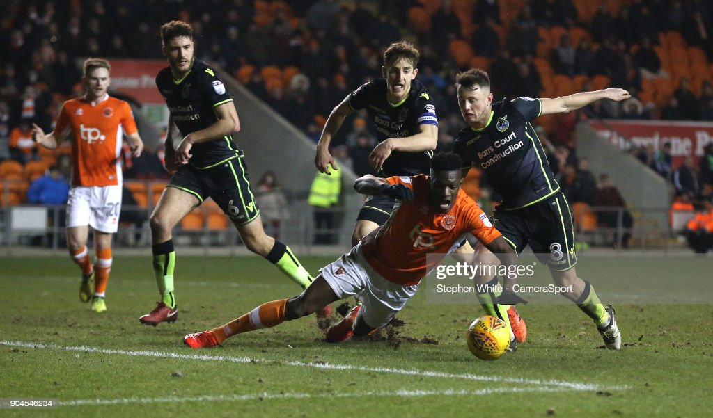 Blackpool's Armand Gnanduillet is denied a penalty as he battles against Bristol Rovers' Ollie Clarke (right) and Tom Lockyer during the Sky Bet League One match between Blackpool and Bristol Rovers at Bloomfield Road on January 13, 2018 in Blackpool, England.