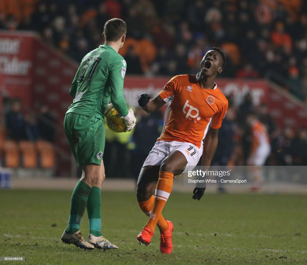 Blackpool's Armand Gnanduillet reacts as Bristol Rovers' goalkeeper Adam Smith beats him to the ball during the Sky Bet League One match between Blackpool and Bristol Rovers at Bloomfield Road on January 13, 2018 in Blackpool, England.